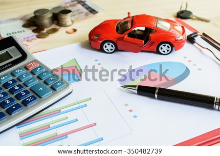 Car expenses calculate with notes and toy car - stock photo