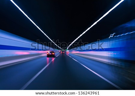 car fast in tunnel with blur light - stock photo