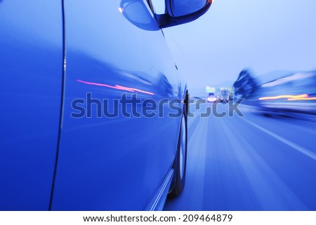 car fast running on road at night - stock photo