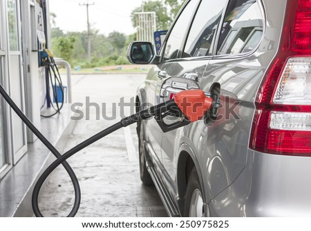 car filling the gas at the station - stock photo