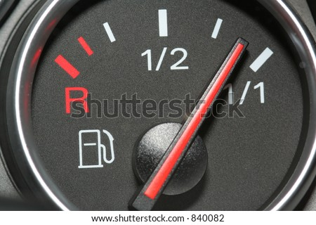 Car fuel gauge full - stock photo