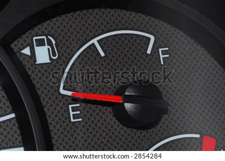 Car fuel gauge showing empty tank