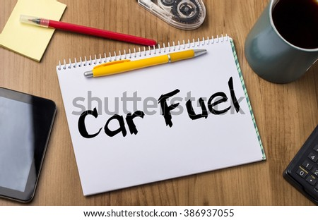 Car Fuel - Note Pad With Text On Wooden Table - with office  tools - stock photo