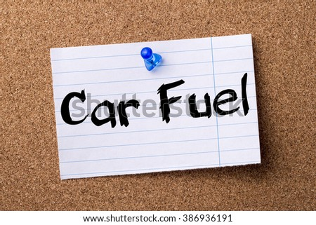 Car Fuel - teared note paper pinned on bulletin board - horizontal image - stock photo