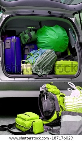car full of luggage bags and travel bags - stock photo