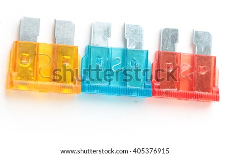 Car fuse. Pile od colorful electrical automotive fuses or circuit breakers isolated on white background, top view.
