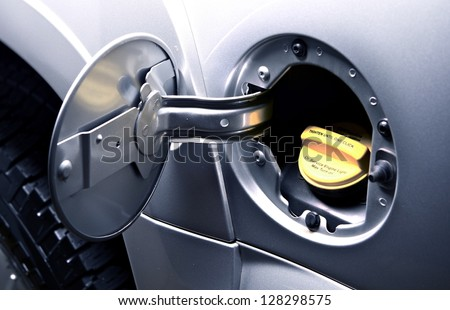 Car Gas Tank - Fueling Theme. Closeup. Transportation Photo Collection. - stock photo