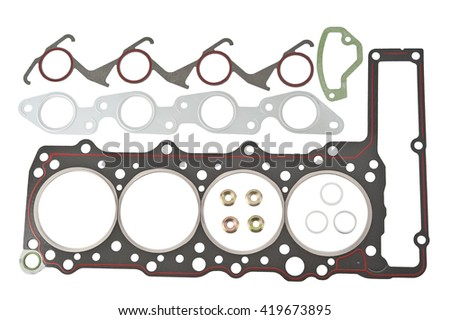 Car Gasket Set, cylinder head Separated. Crankshaft oil seal engine isolated on white background Auto Spare parts. A large set of gaskets for the engine of a passenger car.  - stock photo