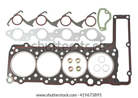 gasket. car gasket set, cylinder head separated. crankshaft oil seal engine isolated on white background