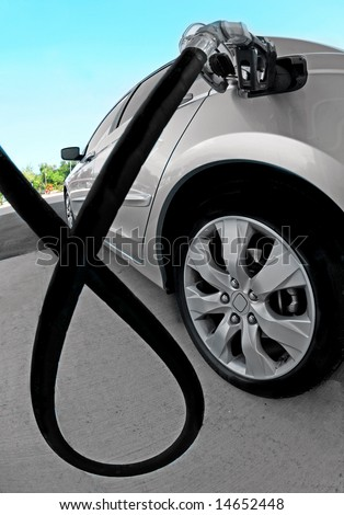 Car getting fuel at gas station - stock photo