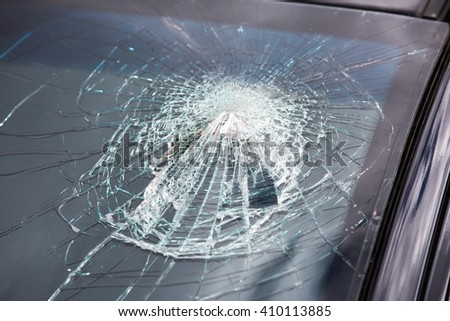 car glass smashed by head because of the belt reminder - stock photo