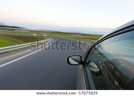 Car goes very fast to turn a country road at night - stock photo