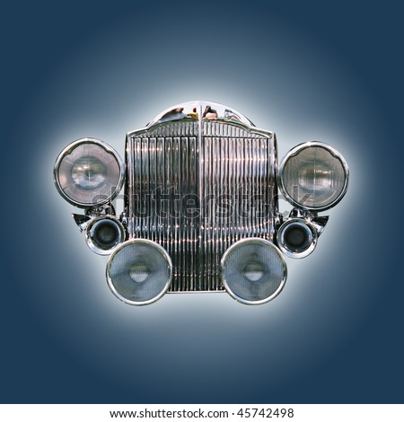 Car grill from the 30ies isolated on blue with clipping path - stock photo