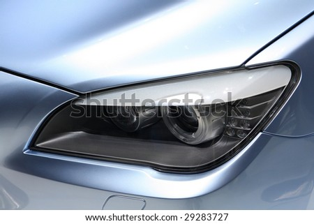 Car headlight - stock photo