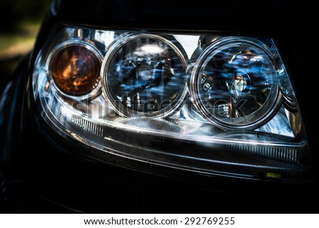 car headlight closeup, components and spare parts of the car, maintenance and tuning - stock photo