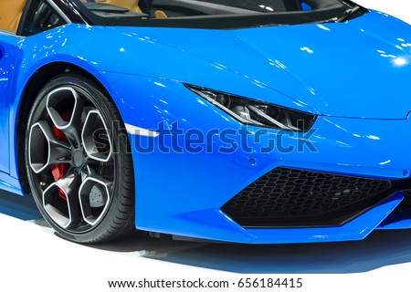 Gentil Car Headlight Of Blue Automobile Closeup Isolated On White Background.