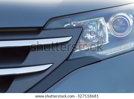 Car headlights and grille.