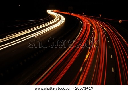 Car headlights on a highway - stock photo