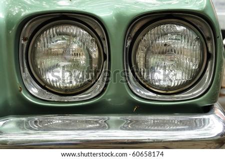 Car headlights retro style - stock photo