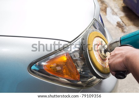 Car headlights with power buffer machine at service station - a series of CAR CARE images. closeup Useful as background for design-works. - stock photo