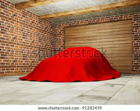 car hidden under a cloth in garage. - stock photo