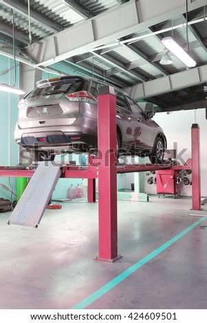 Car in a dealer repair station in Serpuhov, Russia - stock photo