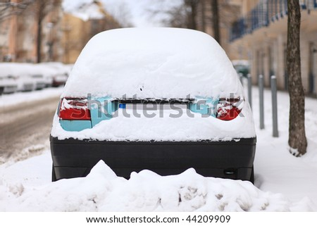 car in a street covered by a lot of snow - stock photo