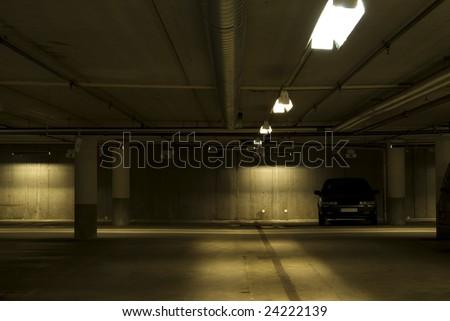 Car in a underground garage - stock photo