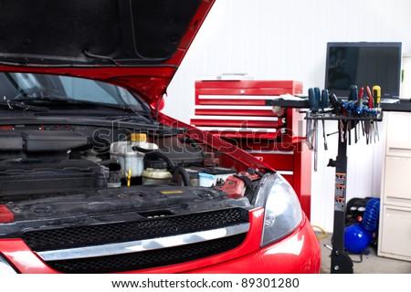 Car in auto repair shop. Service. Garage. - stock photo