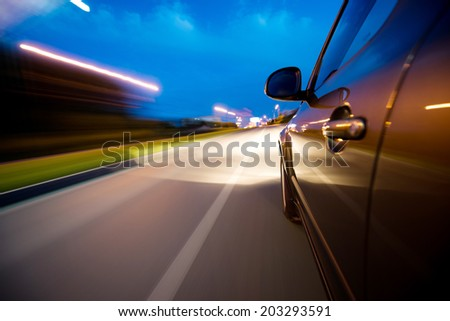 Car in motion at night  - stock photo
