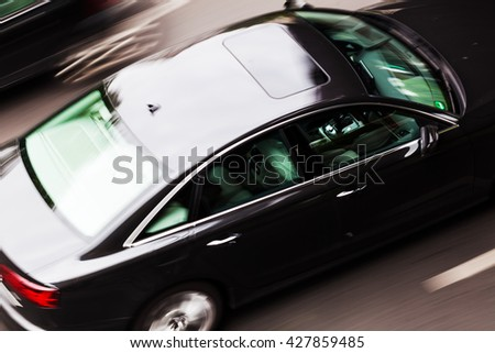 car in motion blur seen from above