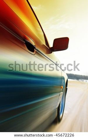 Car in motion on road - stock photo