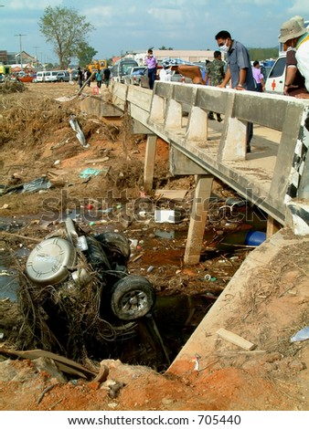 car in river under bridge after tsunami, khao lak, Thailand - stock photo
