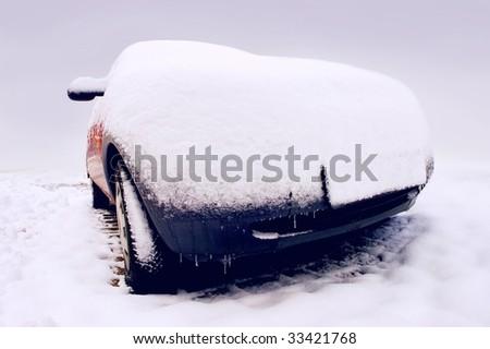 Car in snow in winter - stock photo
