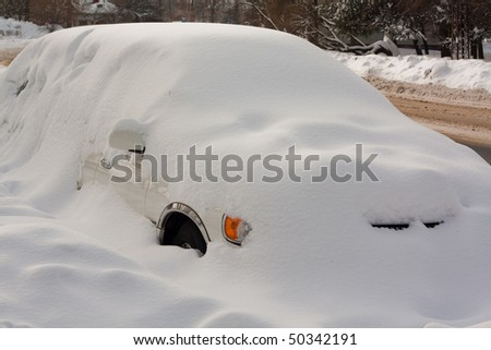 Car in Snowbank in winter - stock photo