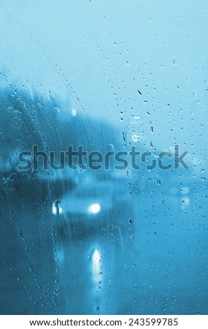 car in town in rainy day - stock photo