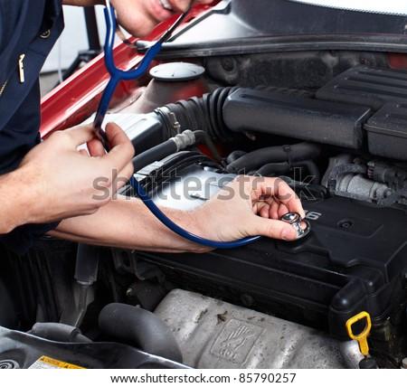 Car inspection in auto repair shop. Mechanic. - stock photo