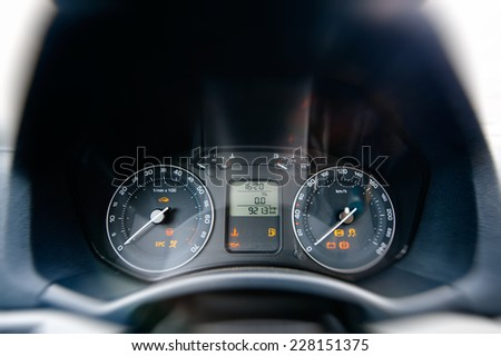 Car instrument panel - frontal view of car dashboard - stock photo