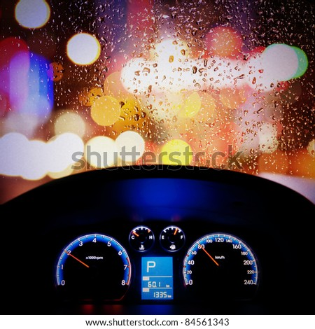 car instrument panel,rain window - stock photo