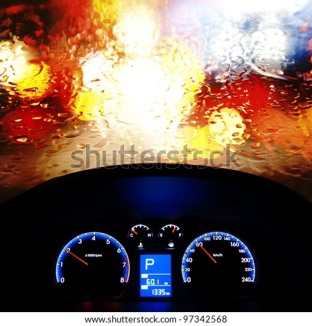car instrument panel,rain window - stock photo