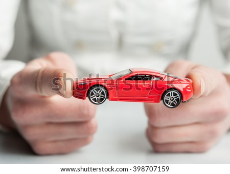 Car insurance. Automobile collision damage waiver concepts. with protective gesture and icon of car. Protection of car. Business concept. Boy with a toy car isolated on white - stock photo