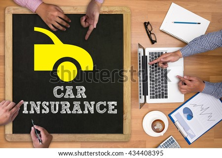 CAR INSURANCE Businessman working at office desk and using computer and objects on the right, coffee,  top view, - stock photo
