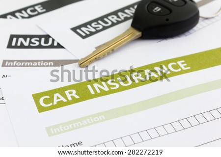 Car insurance form with car key - stock photo