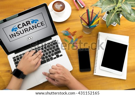 CAR INSURANCE Male person sitting front open laptop computer and smart phone with blank empty screen for your information or content,modern businessman work, top view - stock photo