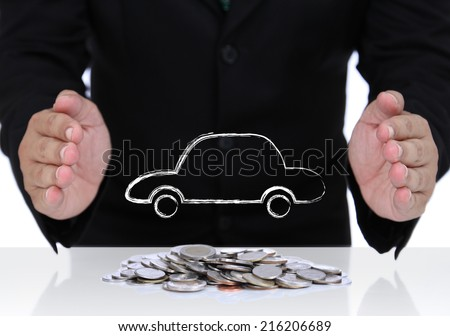 Car insurance with businessman hand and coins - stock photo