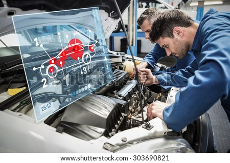 Car interface against team of mechanics working together - stock photo