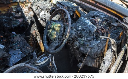 Car interior after fire - stock photo