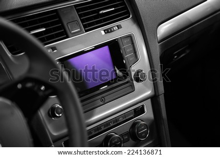 Car interior; Control buttons on dash and steering wheel- detail - stock photo