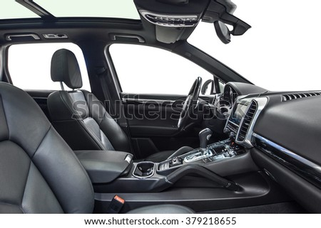 Car interior luxury. Interior of prestige modern car. Leather comfortable seats, dashboard & steering wheel. Black cockpit with exclusive wood & metal decoration on isolated white background. - stock photo