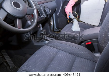Car interior textile seats chemical cleaning with professionally extraction method.  Early spring cleaning or regular clean up. - stock photo